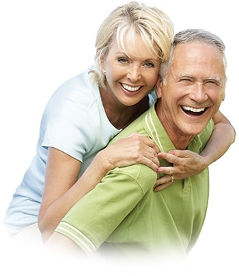 A featured website image for a belleville dentist of a husband piggy backing his smiling wife.
