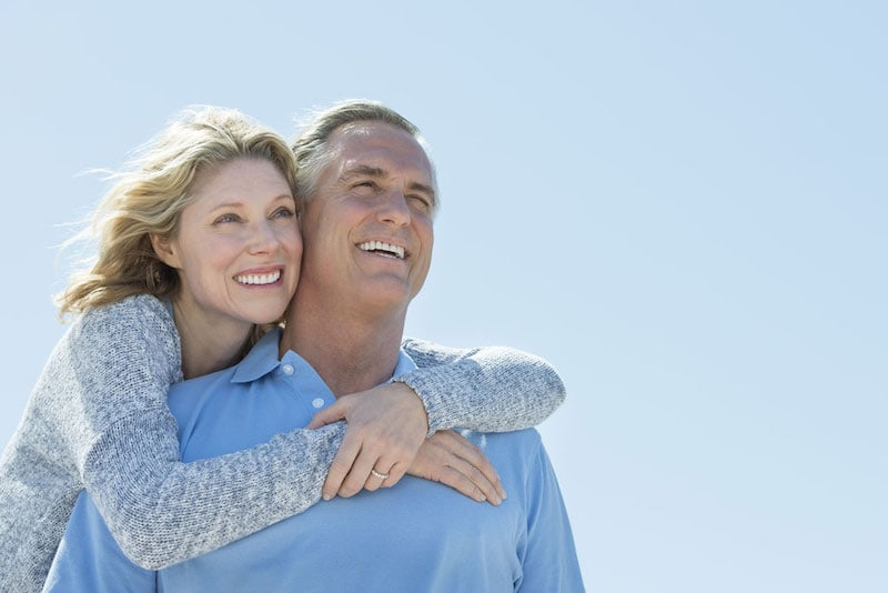 A featured website image for dental implants belleville ontario of a couple who are smiling