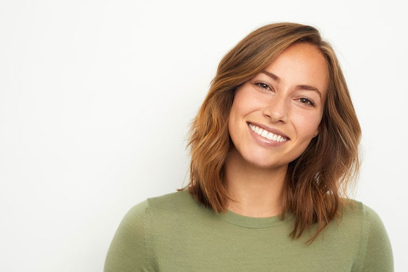 A featured website image for a trenton dentist featuring a woman smiling