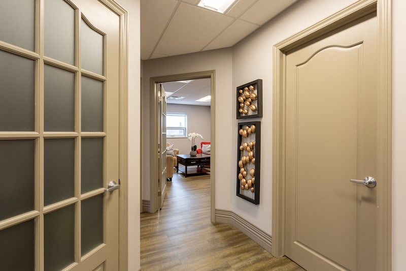 belleville dentist You Make Me Smile Dental Centre's office hallway looking into one of the patient rooms