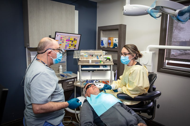 A picture of 2 trenton dentist's discussing results with a patient